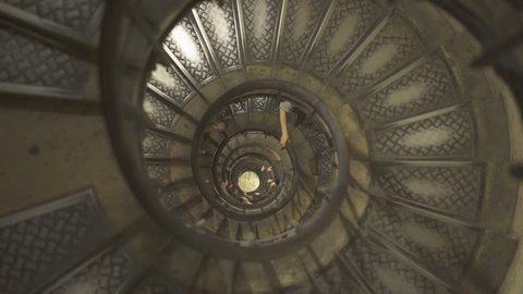 People on Spiral staircase in Arc de Triomphe - September 2018: Paris, France