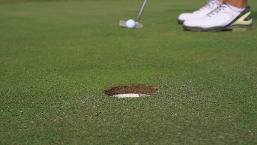 Man golfing and putting in hole. Male player mistake on a golf course - Slider shot | Shutterstock HD Video #1025403890