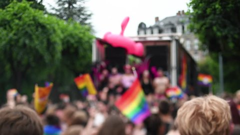 STRASBOURG, FRANCE - CIRCA 2018: Large crowd of people dancing under house trance electronic music near gay truck with gay and lesbians queers at annual FestiGays pride funny and cool atmosphere