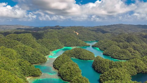 Tropical landscape rainforest hills and azure water in lagoon with clouds. ?oast on the Siargao island, Bucas Grande Island, Sohoton Cove, Philippines. Aerial Drone Timelapse 4K