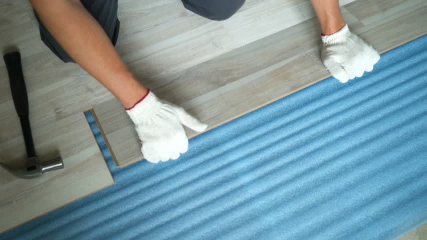 Builder renovating apartment. Repair of the apartment, laying laminate flooring. Construction. | Shutterstock HD Video #1025655860