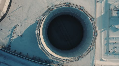 Aerial view; drone flight to huge tubes of thermal power plant; copter circulating over industrial site; view from above of manufacturing stacks; aerial footage of production area, Chelyabinsk region