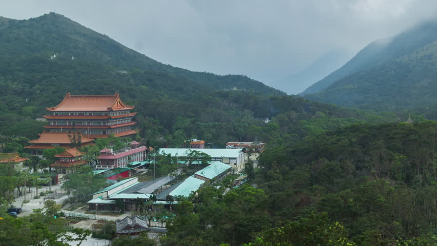 Beautiful temple at Ngong Ping village with misty and mountain background, Hong Kong | Shutterstock HD Video #1025686190