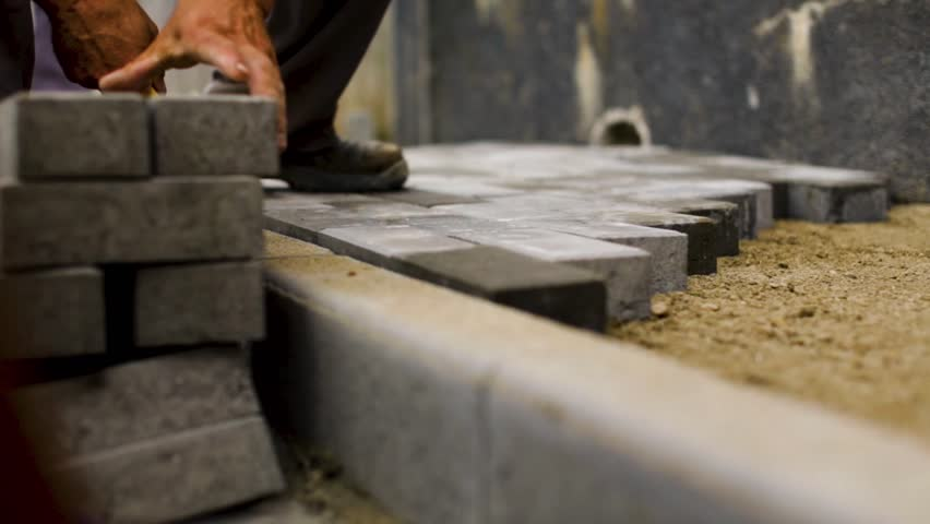 Construction workers laying concrete pavement on the street | Shutterstock HD Video #1025728070