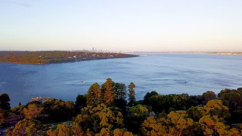 Aerial (drone) video of Point Walter on the Swan River with the Perth City skyline visible on the distance. Perth, Western Australia, Australia.