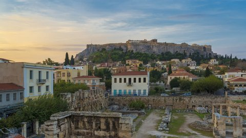 Timelapse 4k, Acropolis Hill with Parthenon of Athens at Colorful Morning and Twilight Time with Aerial rooftop view over the old town Plaka Cityscape of Athens Activities in town, Greece