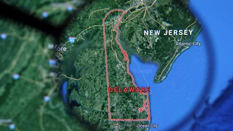MIAMI BEACH. FLORIDA. USA - MARCH 2019: USA, Delaware on the political map. The borders of Delaware. Delaware State under a magnifying glass. Geography of Delaware in the USA