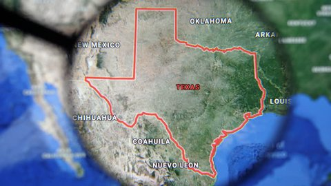 MIAMI BEACH. FLORIDA. USA - MARCH 2019: USA, Texas on the political map. The borders of Texas. Texas State under a magnifying glass. Geography of Texas in the USA
