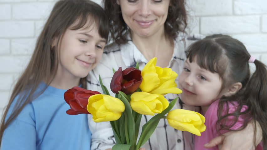 Mothers Day. Daughters give mom flowers. | Shutterstock HD Video #1025828120
