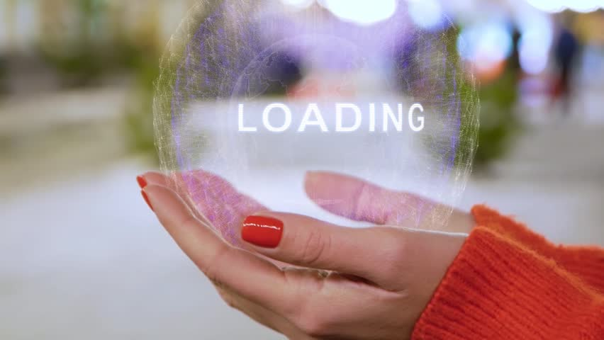 Female hands holding a conceptual hologram with text Loading. Woman with red nails and sweater with future holographic technology on a blurred background of the street | Shutterstock HD Video #1025860100