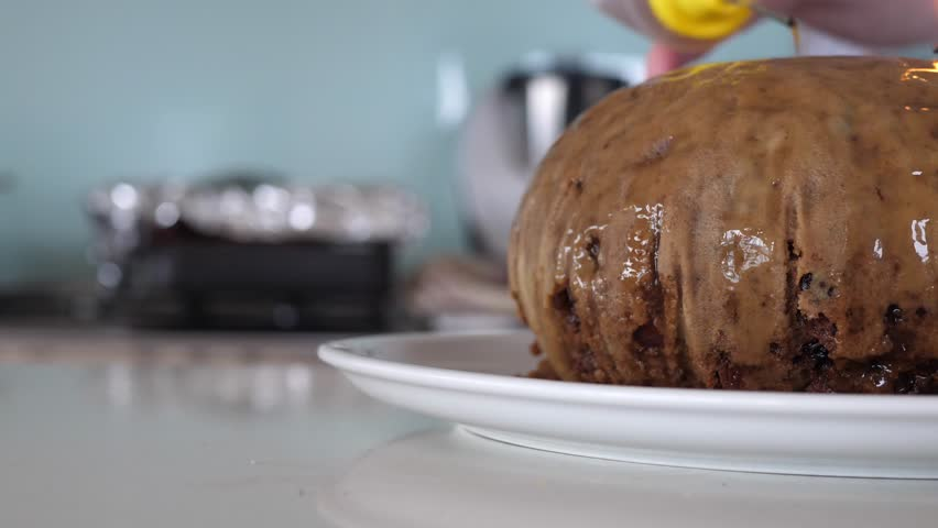 Pouring Alcohol Over Christmas Pudding And Lighting With A Match   Shutterstock HD Video #1025869460
