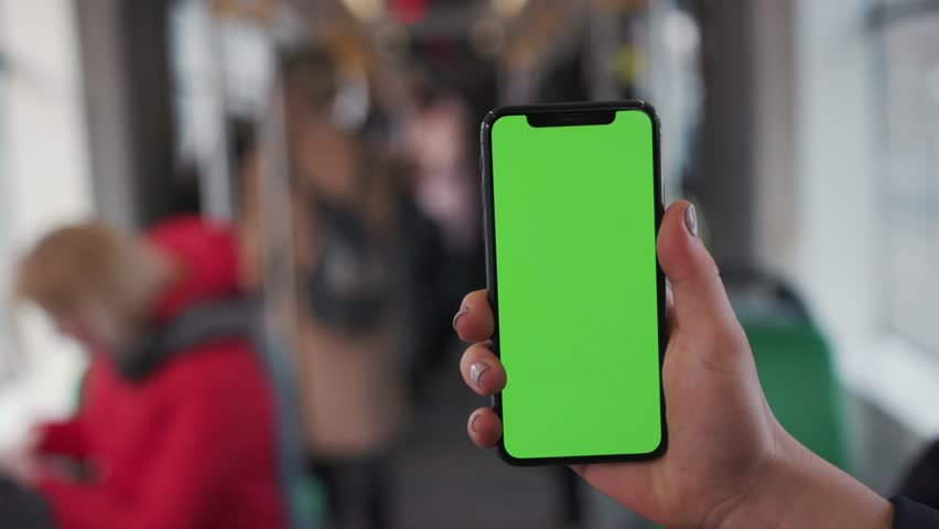 Lviv, Ukraine - May 19, 2018: Close up woman hands use touch holding a mobile telephone with a vertical green screen in tram chroma key smartphone technology cell phone street message slow motion | Shutterstock HD Video #1025899430