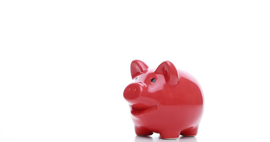 Saving money - pig on white background | Shutterstock HD Video #1026021500