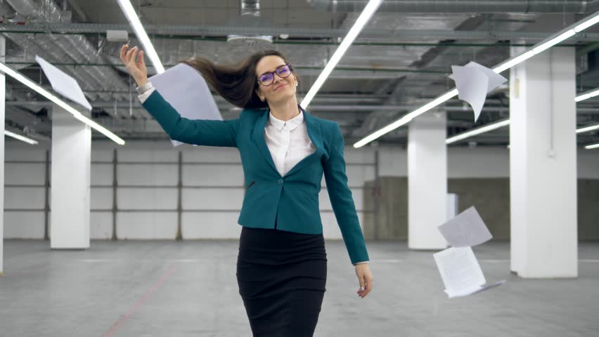 Happy office worker starts to dance and throws away documents. | Shutterstock HD Video #1026030290