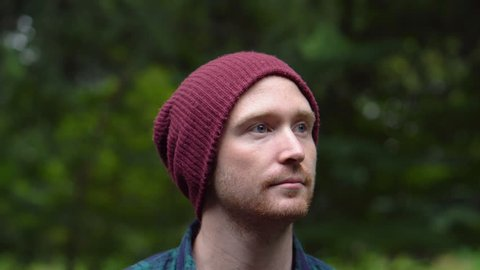 Portrait of Handsome 20s Caucasian Man With Red Beanie in Nature Scenery
