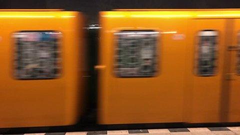 Berlin, Germany - 02/13/2019: Berlin U-Bahn yellow underground slowing down
