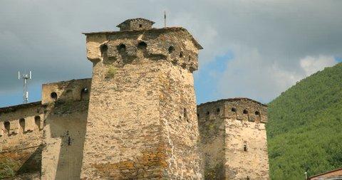 Zoom out from close up  of the stone medieval fortified Svaneti tower houses of  Ushguli, Upper Svaneti, Samegrelo-Zemo Svaneti, Mestia, Georgia.