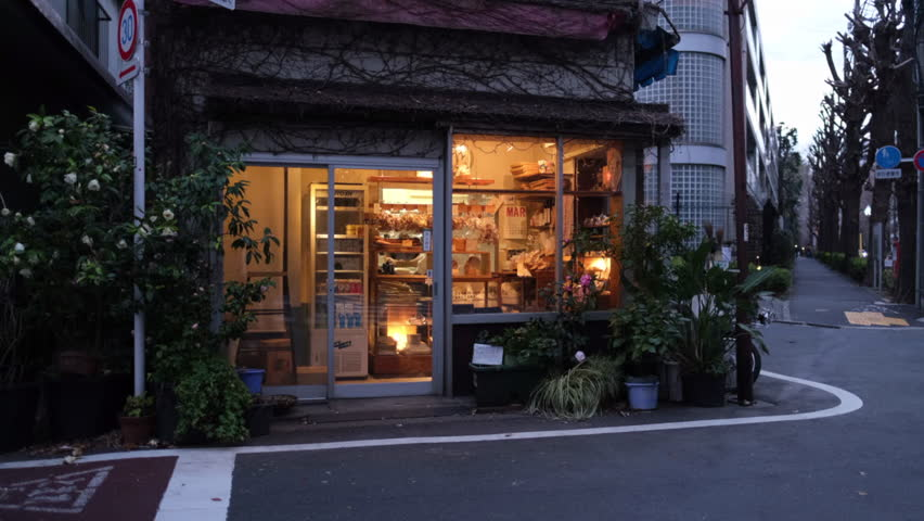 TOKYO, JAPAN - MARCH 24TH, 2019. Little bakery shop in Kamimeguro neighboborhood at dusk.  | Shutterstock HD Video #1026301820