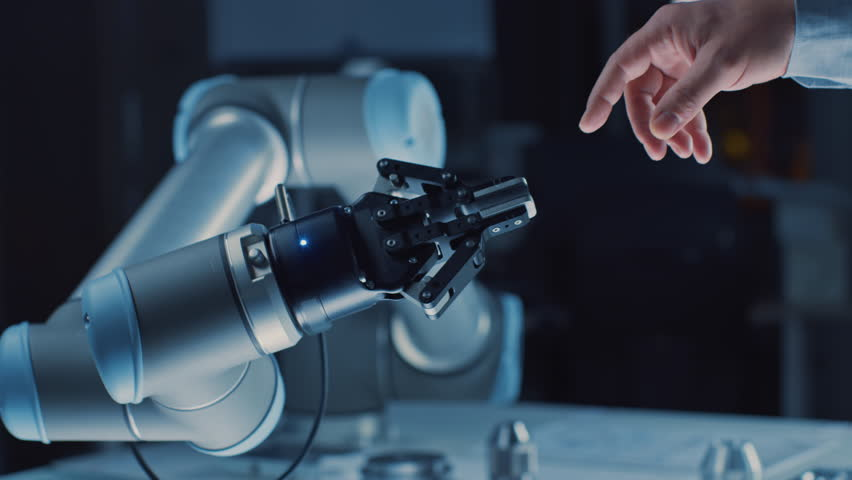 Futuristic Robot Arm Touches Human Hand in Humanity and Artificial Intelligence Unifying Gesture. Conscious Technology Meets Humanity. Concept Inspired by Michelangelo's Creation of Adam | Shutterstock HD Video #1026344120