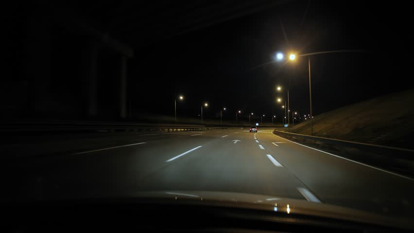 Driving on the highway at night, Moon in the sky | Shutterstock HD Video #1026399170