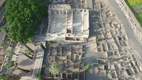 Aerial view of Octagonal St. Peter's Church and the Roman-like ancient synagogue at Capernaum village ruins, at the north part of Sea of Galilee. Israel.