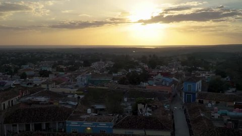 Sun setting in the see over Trinidad Cuba, wide or establishing shot.
