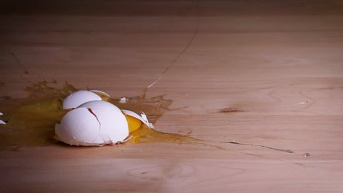 An egg falling and breaking open. Shot with a high-speed camera.