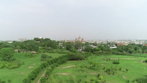 4K aerial of flying over a beautiful green forest in a urban landscape, Delhi, India