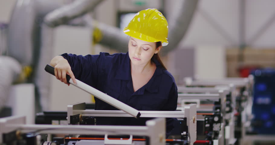 4K Beautiful female engineer carrying out maintenance & repairs on factory machine | Shutterstock HD Video #1026605960