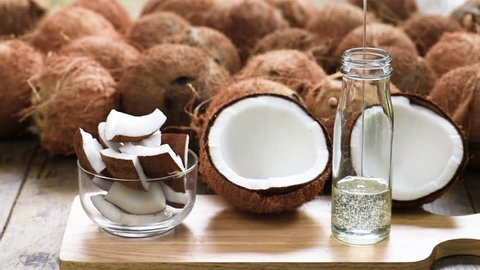 Organic  coconut oil is putting in the bottle.  Oil from coconut is a superfood or heathy food. No cholesterol. Organic coconut oil is many benefit for cooking, wash or clean hair, skin and massage.