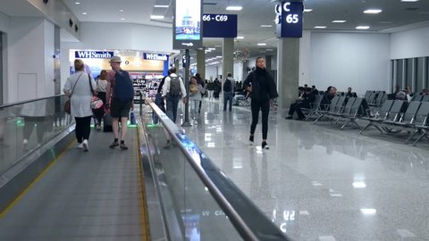 Rio de Janeiro, Brazil - March 28, 2019: Point of view (POV) on moving walkway at Galeao Rio de Janeiro International Airport (GIG), which served 16.2m passengers in 2016