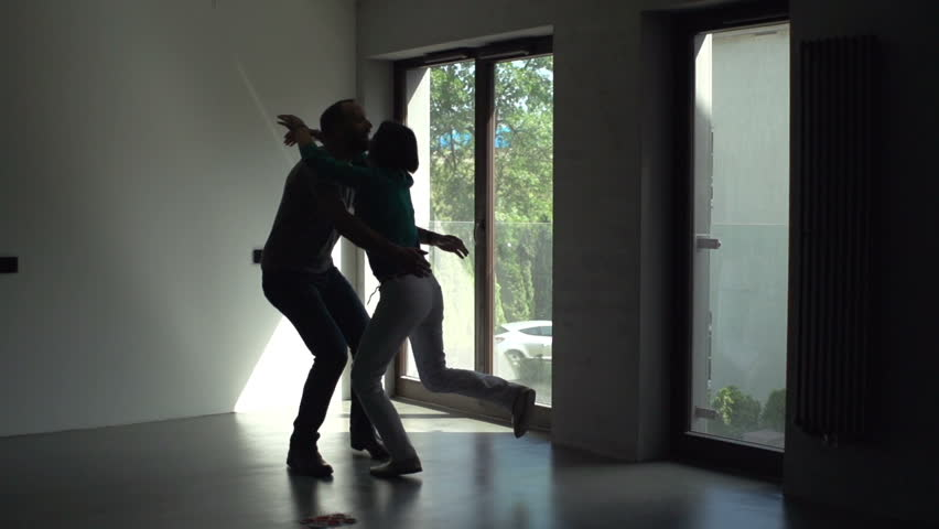 Happy couple dancing at their new home | Shutterstock HD Video #1026658010