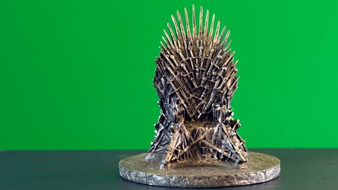 Games of Thrones HBO authorized replica of the Iron Throne, dolly shot against green screen. Adelaide, South Australia - February 6, 2019.
