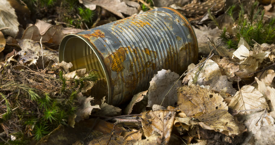 Rusty empty used tin can on forest floor as an environmental pollution closeup | Shutterstock HD Video #1026709580