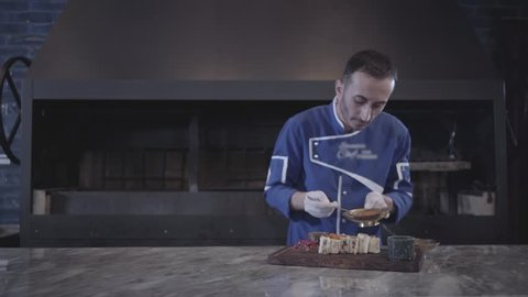 Chef cooking tasty kebab wrapped in lavash pita in modern restaurant close up. Turkish cuisine