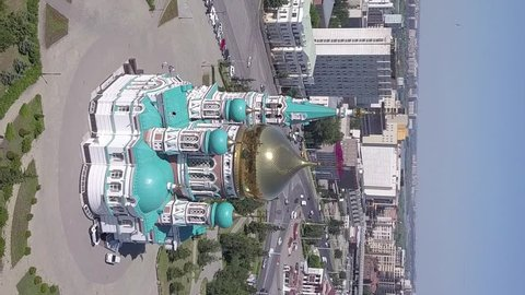 Vertical video. The Cathedral of the Assumption of the Blessed Virgin Mary, panoramic views of the city. Omsk, Russia, From Drone, Point of interest