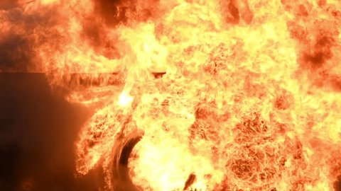 Big real fire of gas and oil explosion bursting through air.The building was burnt down.infernal fire in an industrial factory with big flame and smoke. Looping Fire Flames. Fire wall in slow motion