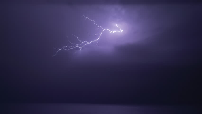 Real flashes of lightning over the sea during a powerful thunderstorm #1026906530