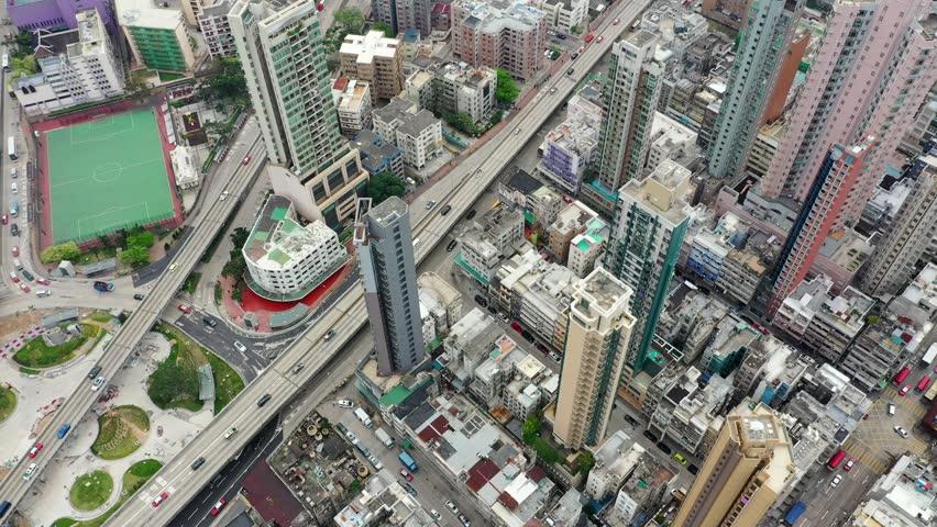 Kowloon City, Hong Kong, 04 April 2019: Drone fly over Hong Kong city | Shutterstock HD Video #1026969440