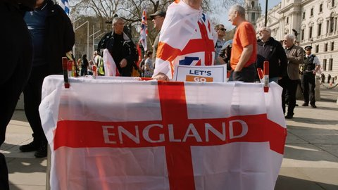 LONDON, 29 March 2019 - Close-up view of a pro BREXIT supporter selling England flags in Westminster Parliament on the day the UK failed to leave the EU