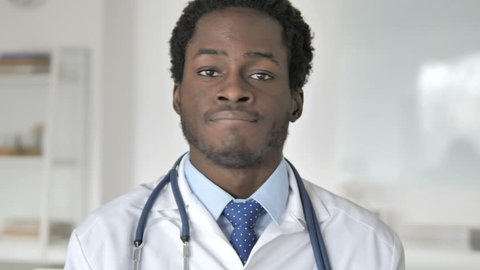 Restricting African Doctor Shaking Head to Express No