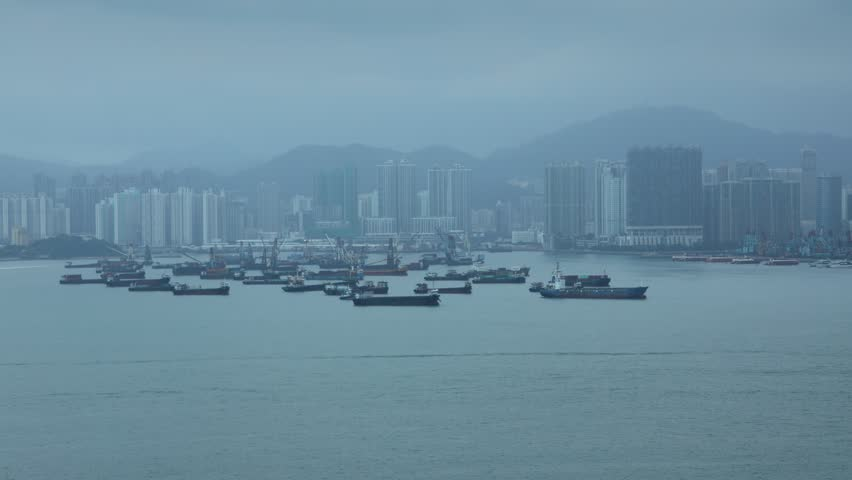 Time lapse. Day view of busy bay between Kowloon and Hong Kong Island full of boats, ferry, ships.
