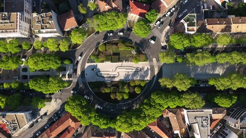 Left to right aerial traveling over a roundabout in Nîmes with avenue Jean-Jaurès France spring