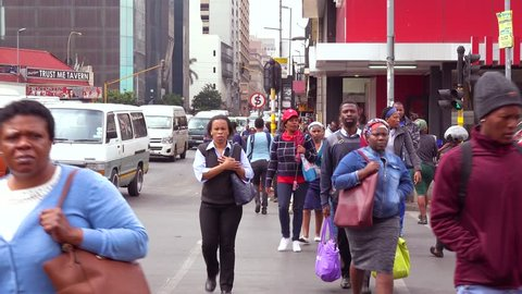 JOHANNESBURG SOUTH AFRICA - CIRCA 2018 - People walk on the streets in the downtown business district of Johannesburg, South Africa.