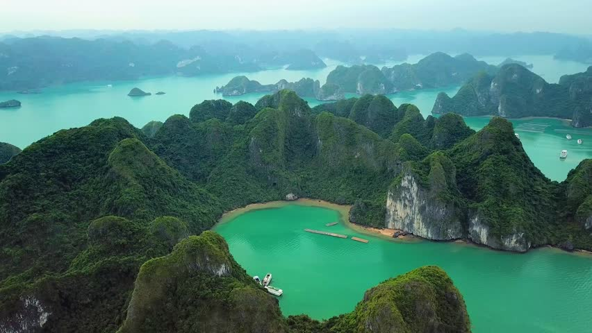 Helicopter tropical Ha Long Bay lot sharp natural rocks sea blue azure water. Wild natural untouched seascape horizon. Famous popular travel sight. Best Asia Vietnam. Drone | Shutterstock HD Video #1027431260