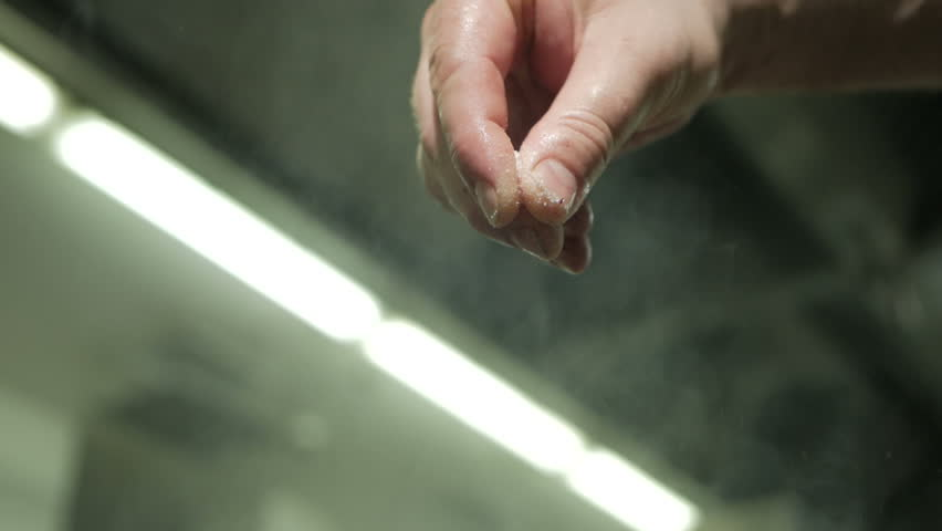 The male hand is heavily salting something. Cook with spices | Shutterstock HD Video #1027557440
