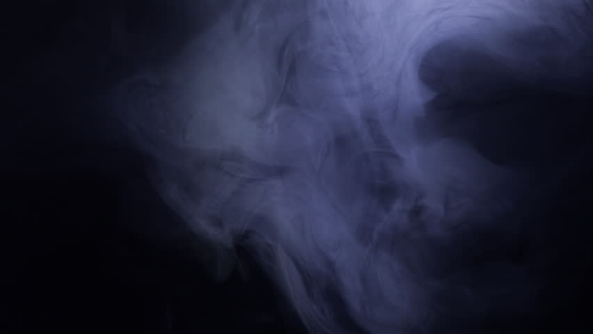 Smoke in slow motion on black background. ?olor smoke slowly floating through space against black background. | Shutterstock HD Video #1027601060
