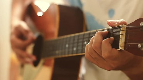 Man playing guitar with slow motion shoot music musician classic chord acoustic free time holiday summer. Use for illustration or insert.