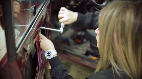 feminized girl master service the blonde working on the old car in to the mechanic for repair