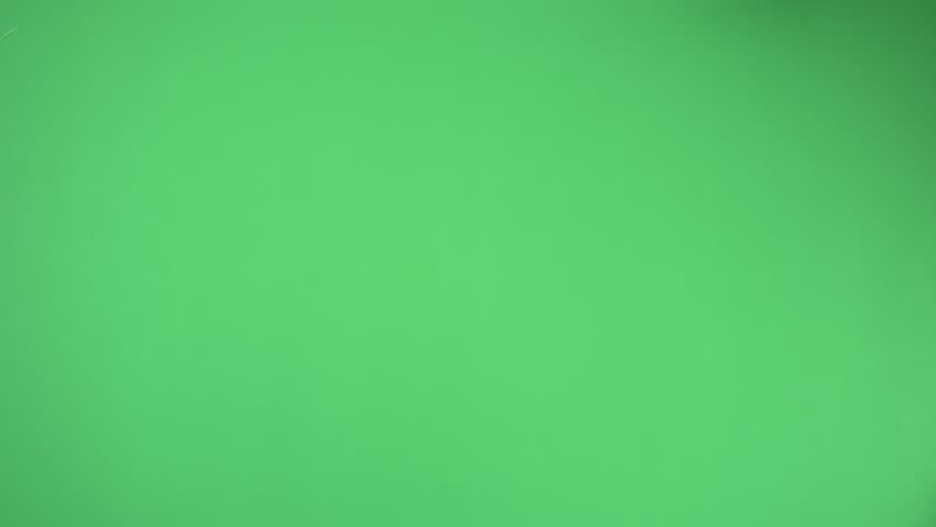 Series of hand gestures on a green screen simulating a touchscreen. | Shutterstock HD Video #1027633850